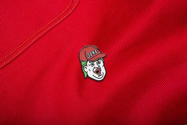 sagmeister-walsh-trump_joker-pin