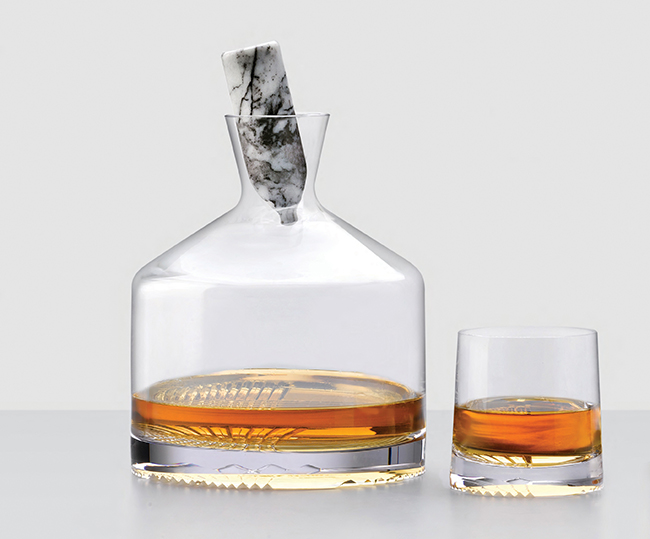 Alba Decanter Set for Nude Glass, paying homage to Scotland, the spiritual home of whiskey, through the hand engraved deconstructed Tartan pattern and an omni-directional stopper inviting the owner to always lean it in the direction of Scotland (2016). Photo: Nude Glass