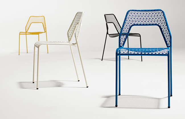 Hot Mesh Chair, featuring powder-coated steel that creates a bold graphic pattern inspired by handwoven rattan and a simple, stackable tubular frame that maintains the clarity of form (Minneapolis, Minnesota, 2012). Photo: Dan Monick