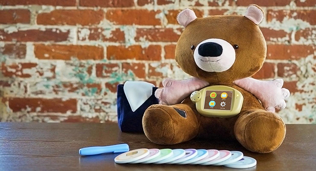 Jerry the Bear, an interactive companion to help children with type 1 diabetes understand how to take ownership of a complex disease. The idea was developed by Aaron Horowitz and Hannah Chung while students in Design for America at Northwestern in response to a DFA project focused on children with type 1 diabetes. Jerry comes with eight injection sites, a sticker to attach a virtual insulin pump, and educational augmented reality games to play on a free mobile application (2009–present). Project partner: Sproutel. Photo: Courtesy of Sproutel