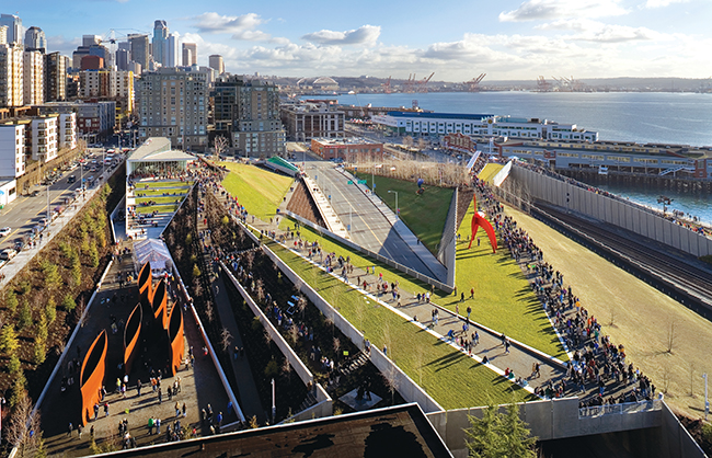 Seattle Art Museum: Olympic Sculpture Park integrates art, architecture, infrastructure, and ecology in a new model for urban sculpture park. The continuous landform connects a museum pavilion, two bridges, site specific collaborations with world renowned artists, and a waterfront beach with a restored salmon habitat (Seattle, Washington, 2007). Photo: Benjamin Benschneider
