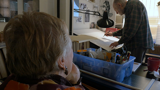 ART PAUL DRAWING AT HIS STUDIO AS HIS WIFE SUZANNE SEED WATCHES 2017