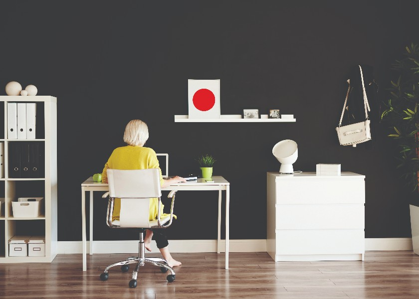 Rear view of businesswoman working at home office